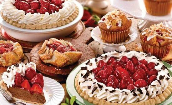 Table holding pies, tarts, and other desserts