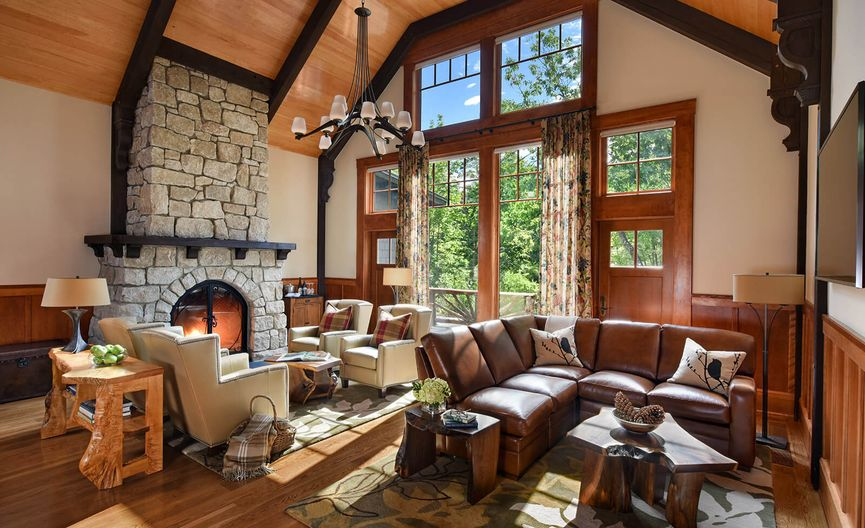 Lodge living room with fireplace and big windows